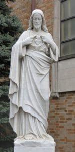 Sacred Heart religious statue. Marble religous sculpture
